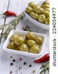 marinated olives on table close ... | Shutterstock . vector #224054977