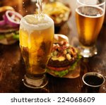 beer being poured into glass... | Shutterstock . vector #224068609