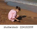 little girl near the  sea | Shutterstock . vector #224132359