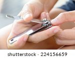 hand manicure with nail clipper  | Shutterstock . vector #224156659