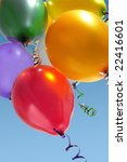 Colorful balloons rising up in the air - stock photo