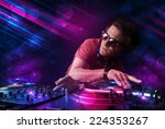 attractive young dj playing on... | Shutterstock . vector #224353267