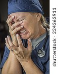 Small photo of Hysterical Agonizing Crying Female Doctor or Nurse.
