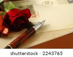Small photo of romance vintage postcard and red rose