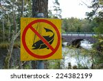 Sign No Fishing At A River Wit...