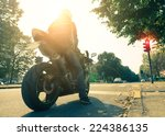 Постер, плакат: Motorcyclist on the road