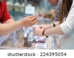 woman trying wedding rings at a ... | Shutterstock . vector #224395054