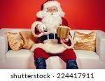 Traditional Santa Claus Sittin...