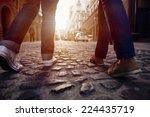 Stock photo tourist couple walking on cobblestone street vacation in europe on holiday break 224435719