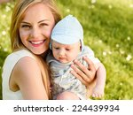 close up of smiling mother with ... | Shutterstock . vector #224439934
