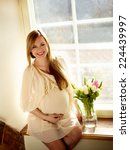 happy pregnant woman sitting... | Shutterstock . vector #224439997