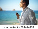 handsome young man spray... | Shutterstock . vector #224496151