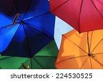 many bright vivid umbrellas... | Shutterstock . vector #224530525