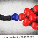 one big blue glove vs the...   Shutterstock . vector #224565325