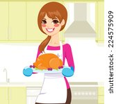 beautiful young woman cooking... | Shutterstock .eps vector #224575909