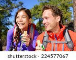 Stock photo couple eating muesli bar hiking happy people enjoying granola cereal bars living healthy active 224577067