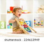 Child Boy Playing With Abacus