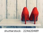 Red Women Shoes On Wooden...