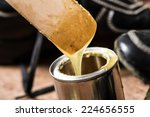 Small photo of closeup rubber adhesive on wooden desk