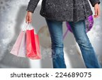 smiling woman holding shopping... | Shutterstock . vector #224689075