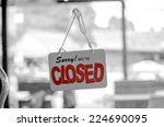 closed sign board hang on the... | Shutterstock . vector #224690095