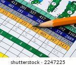 A Golf Scorecard And Pencil