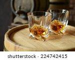 glasses of brandy in cellar... | Shutterstock . vector #224742415