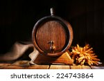 Old Barrel With Wheat On Table...
