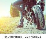 Biker Taking A Break In The...