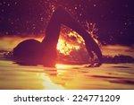 swimming in sunset sunrise. | Shutterstock . vector #224771209