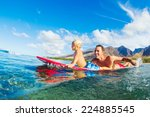 father and son surfing together | Shutterstock . vector #224885545