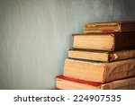 old books on a wooden table.... | Shutterstock . vector #224907535
