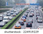 Small photo of BEIJING-OCT. 19, 2014. Traffic jam in smog covered city. Beijing smog alert went to orange, means 'hazardous', maily caused by exhaust emission of five million cars and coal burning in close regions.