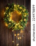 Christmas Wreath On A Wooden...