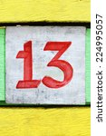 Stock photo number thirteen painted on an old colored wood 224995057