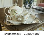 Ceramic Teapot And Cups On A...