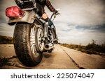 Biker Girl Riding On A...