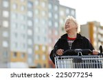 elderly woman with shopping... | Shutterstock . vector #225077254