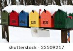 Colorful Mailboxes Covered In...