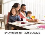 young latin family having... | Shutterstock . vector #225100321