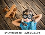 child pilot with vintage plane... | Shutterstock . vector #225103195
