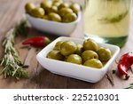 marinated olives on table close ... | Shutterstock . vector #225210301