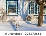 heat pump unit on the side of a ... | Shutterstock . vector #225273661