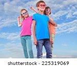 group of happy friends wearing... | Shutterstock . vector #225319069