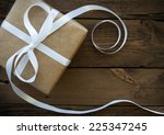 gift with white ribbon with... | Shutterstock . vector #225347245