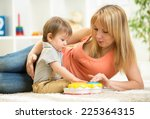 mother and kid boy having fun... | Shutterstock . vector #225364315