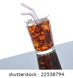 Cold Glass of Cola  with two Straws on gray background with reflections - slanted - stock photo