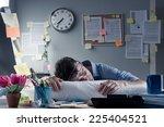 Exhausted Businessman Sleeping...