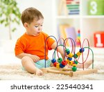 funny child playing with... | Shutterstock . vector #225440341