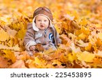 Cute Baby In Autumn Leaves....